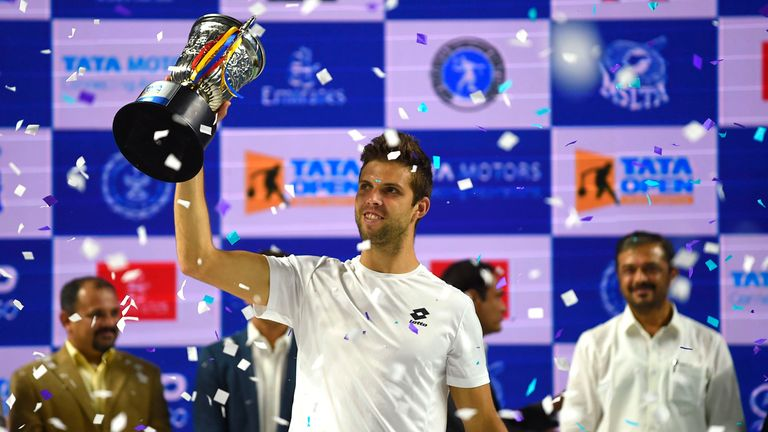 Jiri Vesely of Czech Republic lifts the trophy after edging out Egor Gerasimov of Belarus