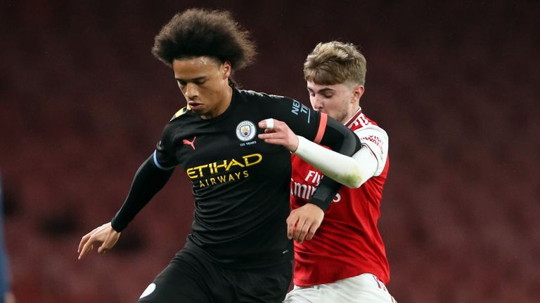 Sane battles for possession with Zak Swanson during the Premier League 2 match between Arsenal U23 and Manchester City U23