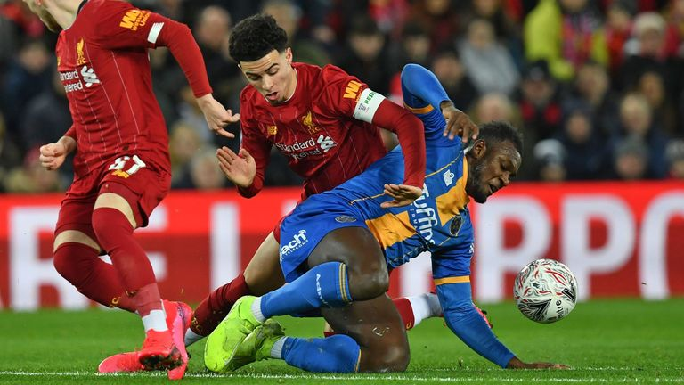 Shrewsbury's Aaron Pierre vies with Curtis Jones for possession