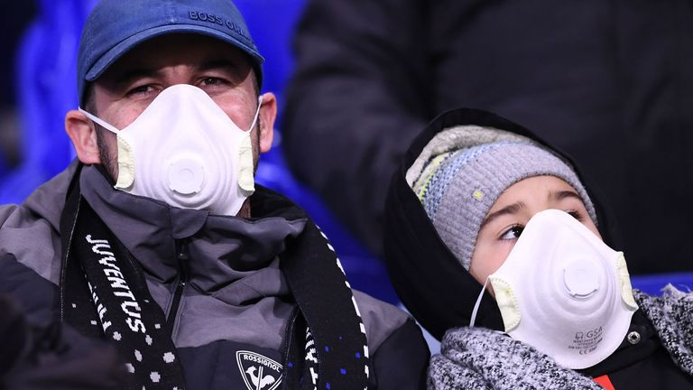 Juventus fans are pictured wearing protective masks during the UEFA Champions League, round-of-16 first-leg match against Lyon
