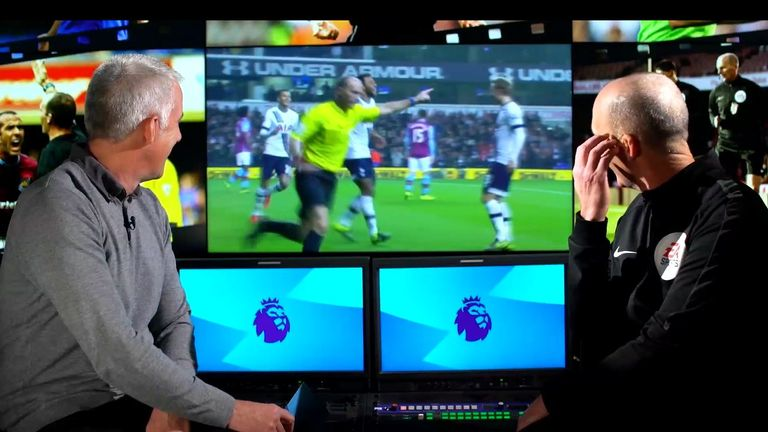 Mike Dean wheels away in celebration after Moussa Dembele scores for Tottenham after he plays advantage