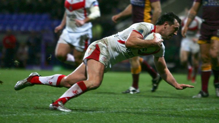 Paul Sculthorpe scores one of his two tries against the Broncos