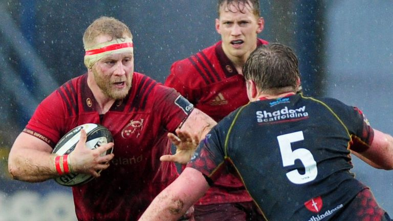 Jeremy Loughman (L) of Munster in action against the Dragons