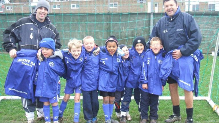McCallum (C) pictured with team-mates and coaches during his time at Herne Bay Youth FC
