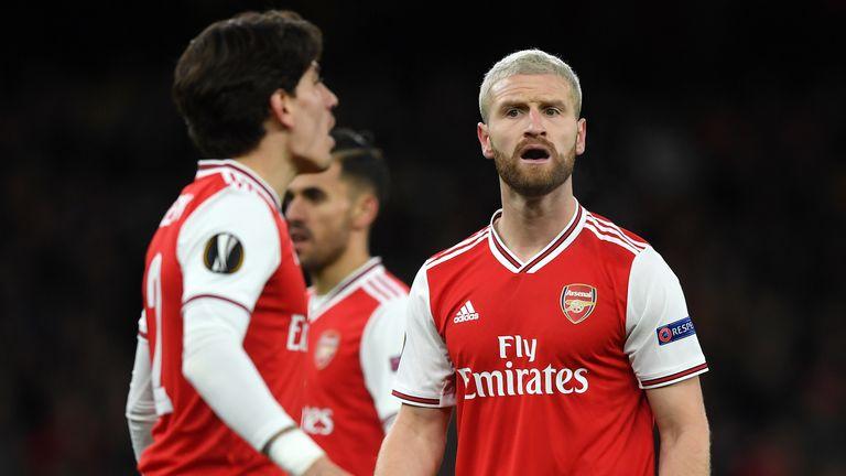 Shkodran Mustafi reacts after Olympiakos' goal against Arsenal