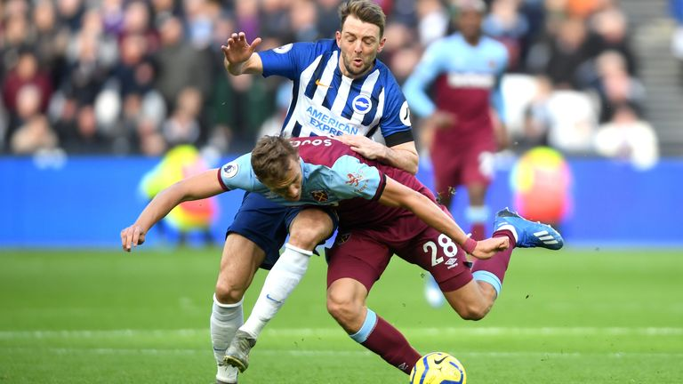 Stephens challenges West Ham's Tomas Soucek earlier this season