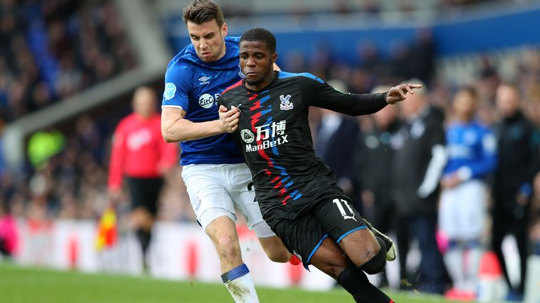 Zaha went to ground in the penalty area under a challenge from Seamus Coleman