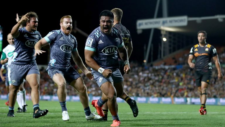 Asafo Aumua of the Hurricanes celebrates after scoring a try