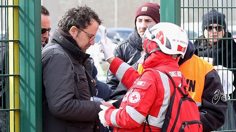 Fans are scanned for signs of Coronavirus by medical personnel before the Serie A match between Lecce and Atalanta on March 1