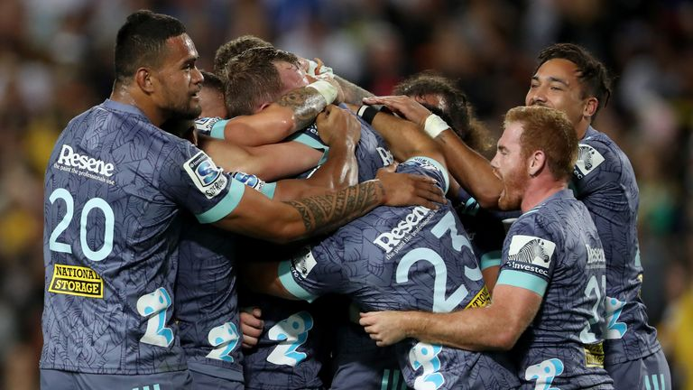 Hurricanes players celebrate after beating the Chiefs