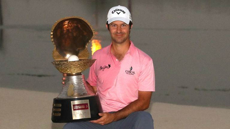 Jorge Campillo proudly displays the Qatar Masters trophy