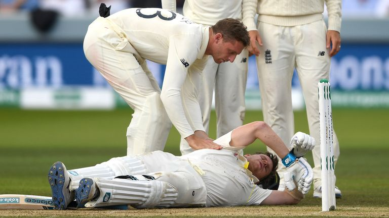 Jos Buttler checks on Steven Smith after the Australian was hit by a ball from Jofra Archer on day four of the second Ashes Test