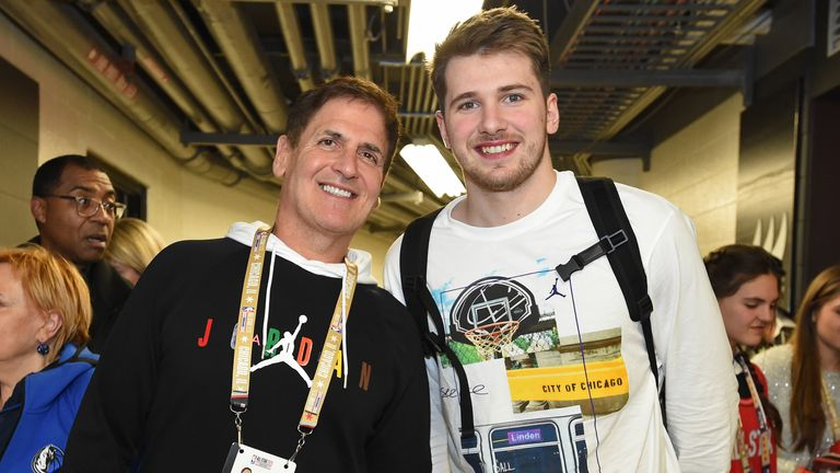 Dallas Mavericks owner Mark Cuban pictured with team star Luka Doncic
