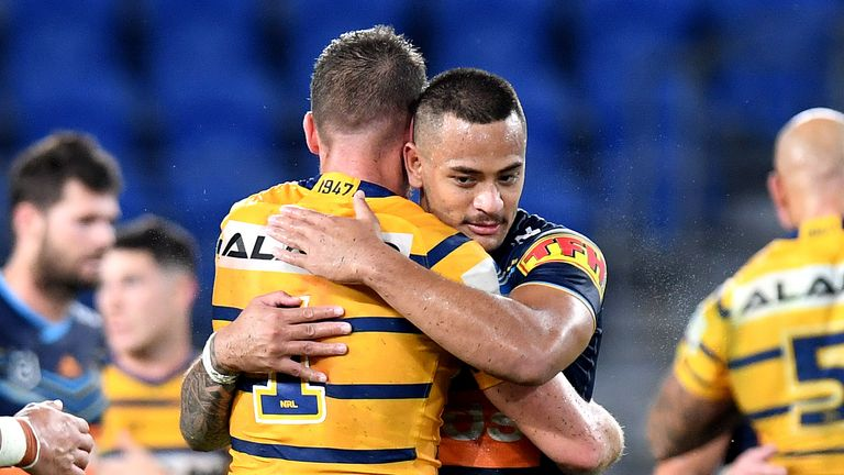 Clint Gutherson of the Eels and Phillip Sami of the Titans embrace after the round 2 NRL match between the Gold Coast Titans and the Parramatta Eels
