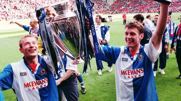 Blackburn strike force of Alan Shearer and Chris Sutton hoist the Premier League trophy in 1995