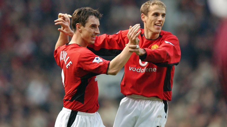 Gary and Phil Neville in action for Manchester United