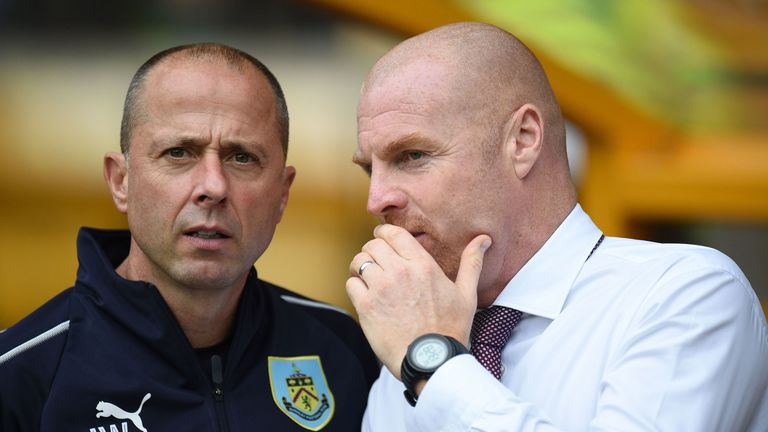 Burnley manager Sean Dyche's assistant Ian Woan (left) has tested positive for the coronavirus