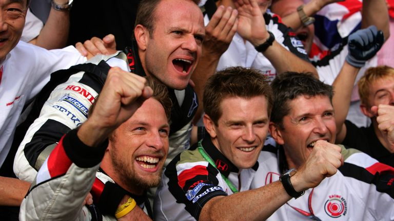 Button celebrates Honda's first victory as a works team for 39 years with Rubens Barrichello, Davidson and Nick Fry