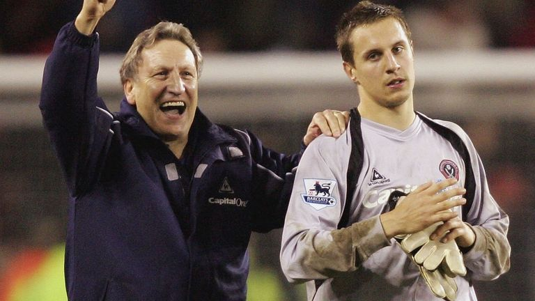 Phil Jagielka is applauded by manager Neil Warnock following his heroics in goal against Arsenal