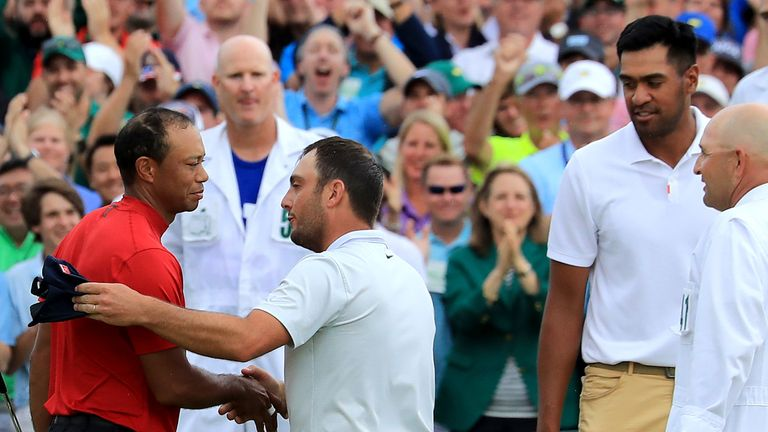 Molinari and Finau were the first to congratulate Woods after his victory