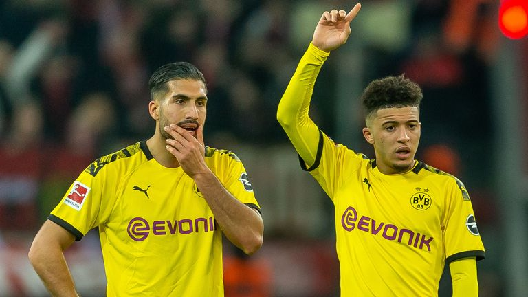 Emre Can (L) says Jadon Sancho (R) needs guidance