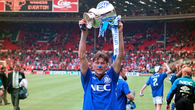 Substitute Duncan Ferguson celebrates with the FA Cup at Wembley