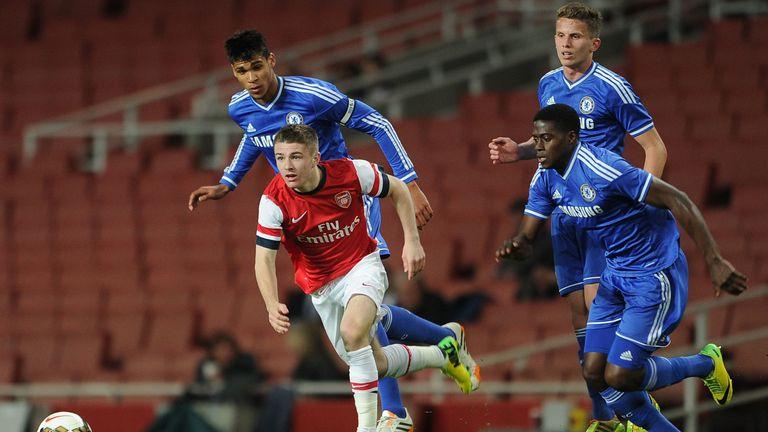 Former Arsenal midfielder Daniel Crowley takes on Ruben Loftus-Cheek, Houghton and Isak Ssewankambo in 2014