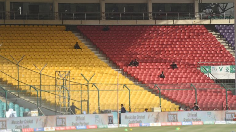 Pakistani paramilitary soldiers sit in empty spectators enclosures at the National Cricket Stadium in Karachi , in February