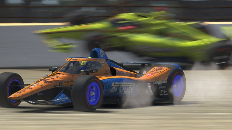 Watch the moment that caused big controversy in IndyCar's iRacing Challenge at virtual Indianapolis as Simon Pagenaud collided with race leader Lando Norris.