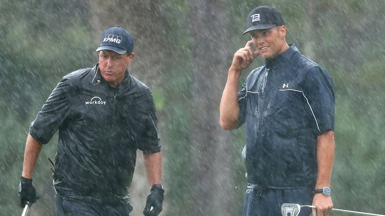 Phil Mickelson and Tom Brady battled on in the rain at Medalist