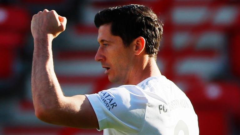Lewandowski celebrates after putting Bayern ahead at Union from the spot