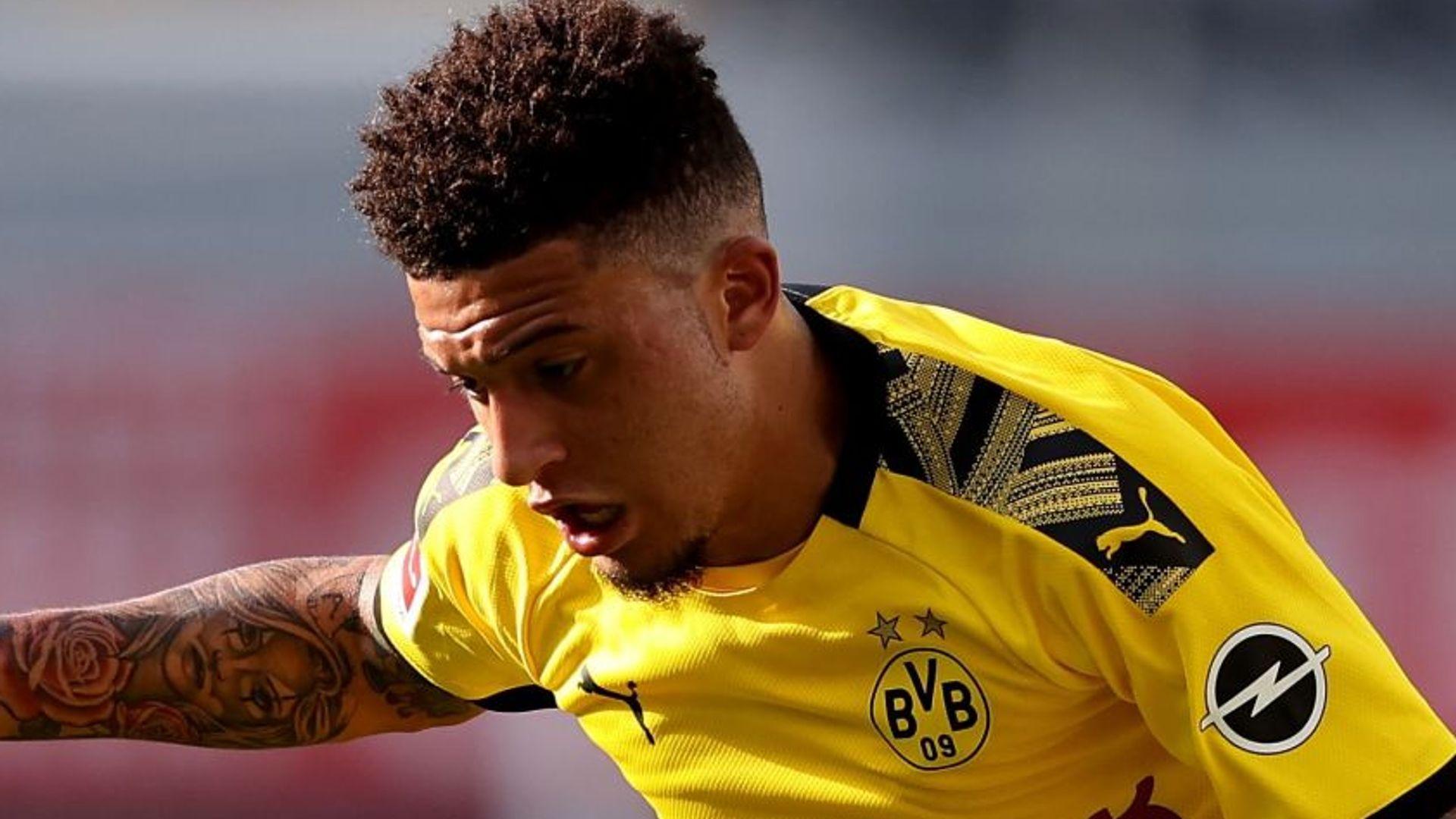 Dortmund defend Sancho over haircut photos