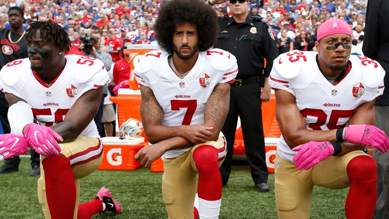 Colin Kaepernick (centre) has not played in the NFL since the 2016 season, when he knelt during the US national anthem