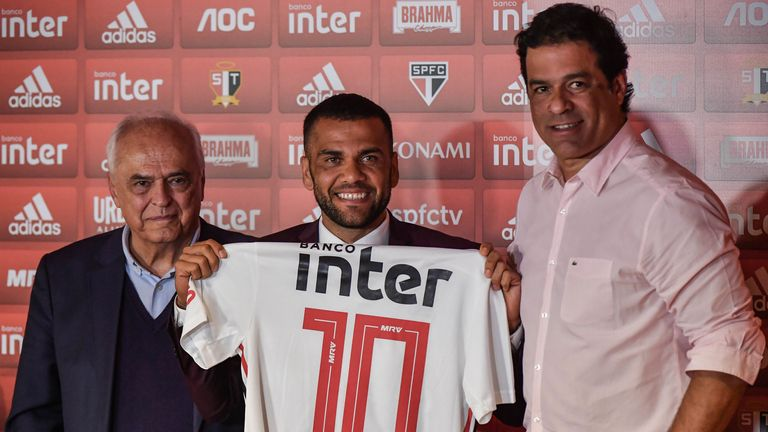 Rai with new signing Dani Alves in his role as general manager of Sao Paulo