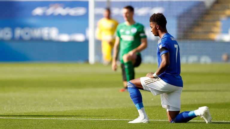 Leicester's Demarai Gray takes a knee at the King Power Stadium