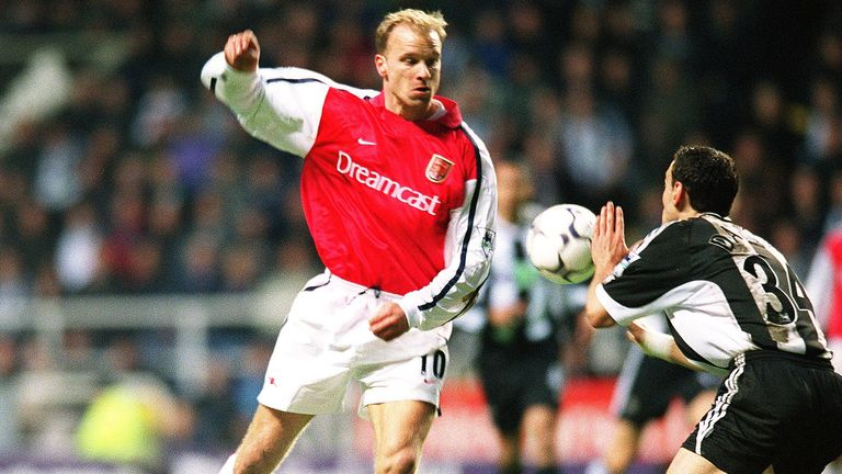 Bergkamp flicks the ball around Newcastle United defender Nikos Dabizas