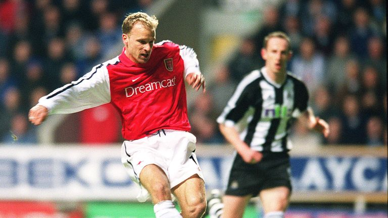 Bergkamp shoots past goalkeeper Shay Given to score in Arsenal's win
