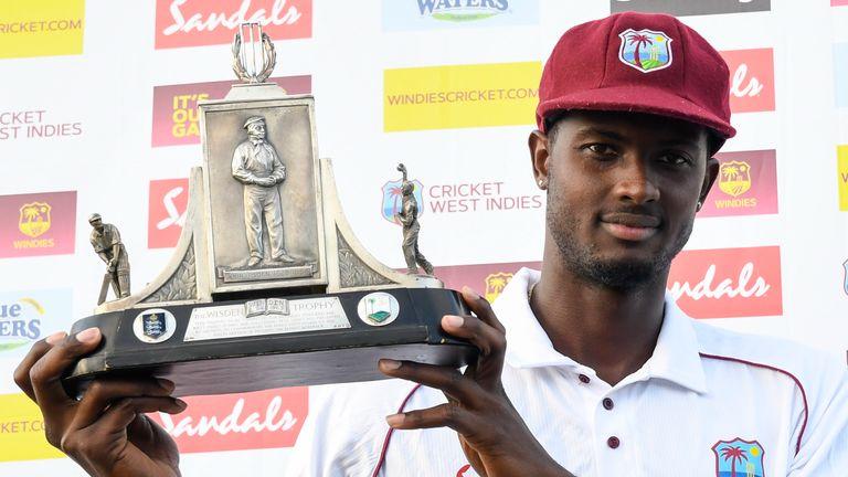 West Indies skipper Jason Holder holds aloft the Wisden Trophy after beating England, in February 2019