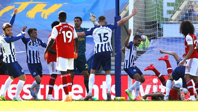 Lewis Dunk bundles the ball over the line to score Brighton's equaliser
