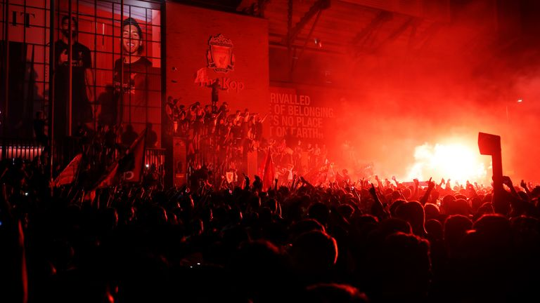 Liverpool fans let off flares outside Anfield
