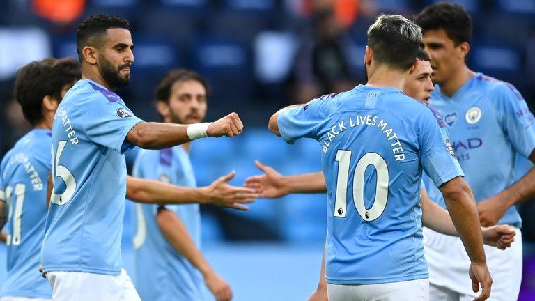 Riyad Mahrez celebrates with team-mates after netting post-restart