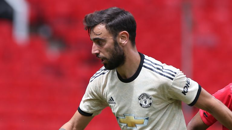 Bruno Fernandes carries the ball during a Manchester United first-team training session at Old Trafford