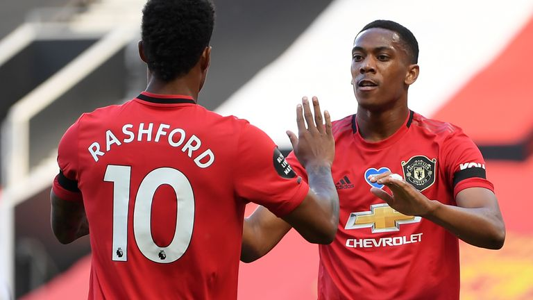 Marcus Rashford celebrates with Martial