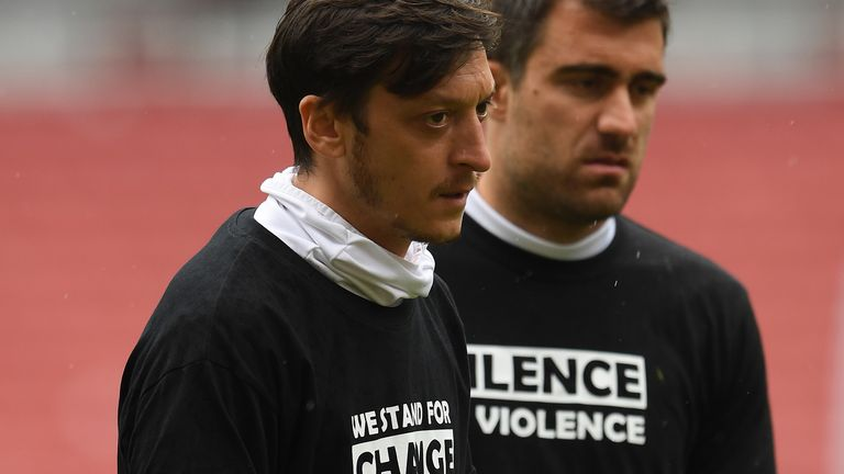 Mesut Ozil warms up at half-time during the friendly