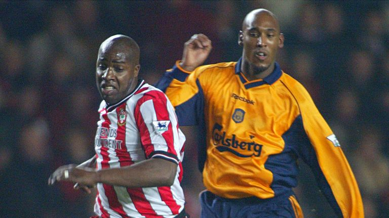 Williams chasing for the ball against Liverpool forward Nicolas Anelka