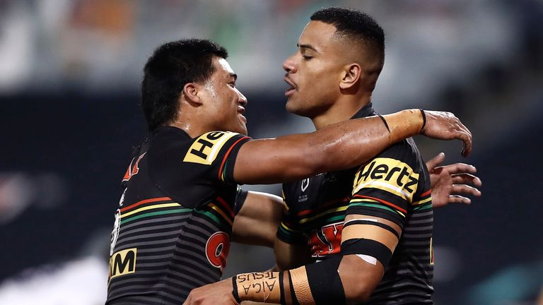 Stephen Crichton and Brian To'o celebrate a try in Penrith's win over Melbourne