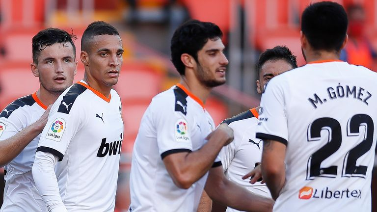 Goncalo Guedes (centre) scored and assisted Valencia's two goals