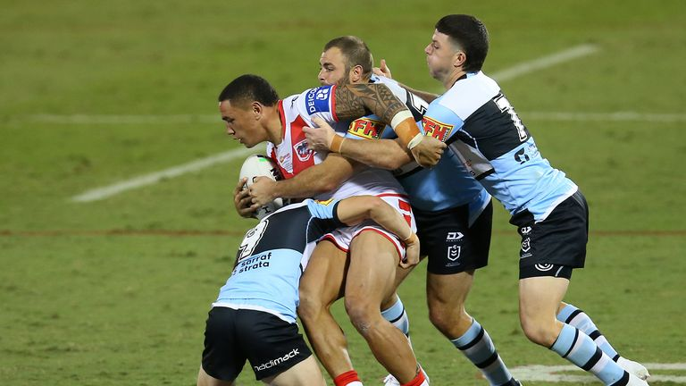 Tyson Frizell  is wrapped up by the Sharks defence