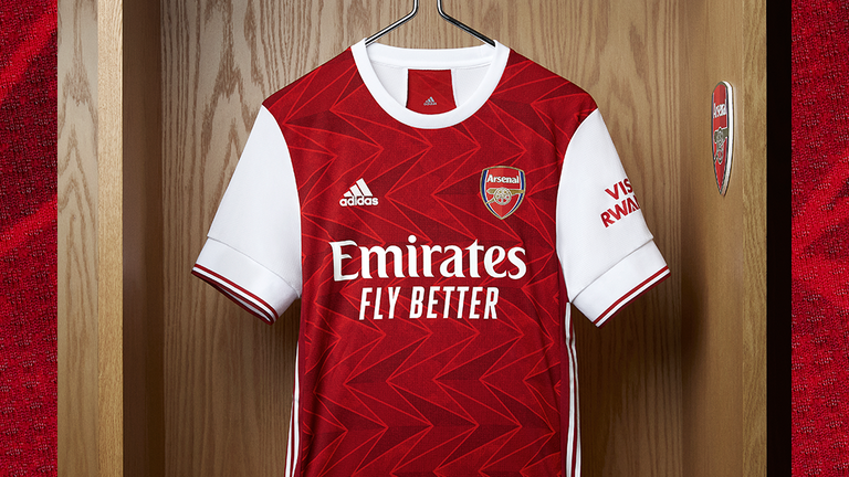 A dark shade of red is used throughout Arsenal's 2020/21 home kit to celebrate the club's heritage