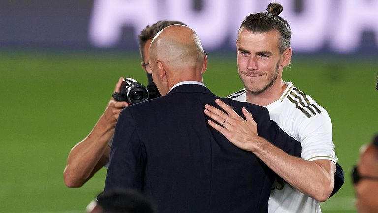 Zinedine Zidane and Bale embrace during Real Madrid's title celebrations